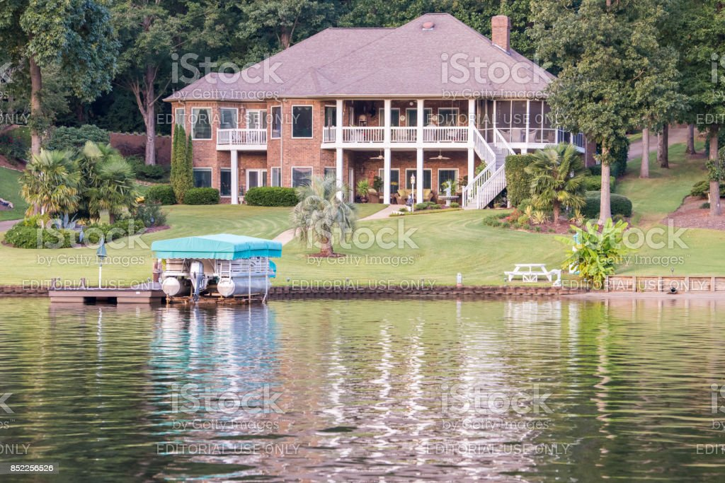 Luxurious home on Lake Bowen in upstate South Carolina Inman, South Carolina, Sept. 9, 2017: A large, luxurious, beautiful home along Lake Bowen, the largest lake in Spartanburg County and a popular place for fishing, boating and swimming in Upstate S.C. Apostasy Stock Photo