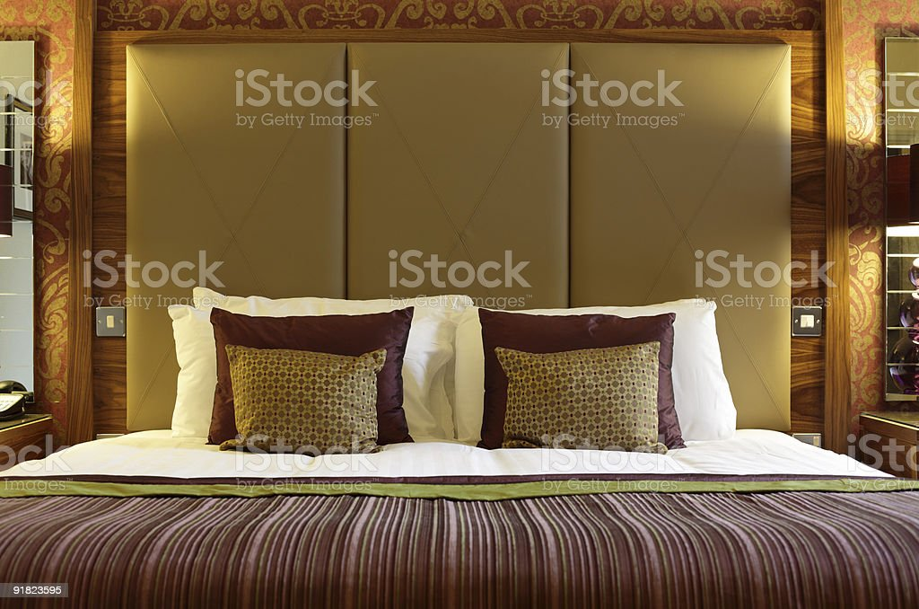 Luxurious hotel bed stock photo