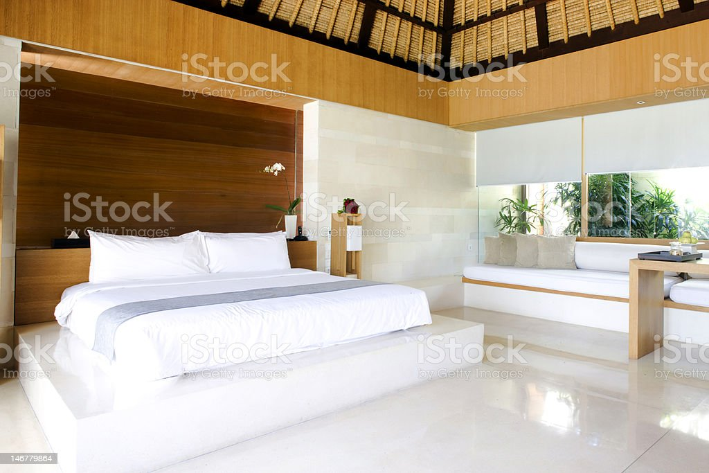 Luxurious hotel room with king sized bed royalty-free stock photo