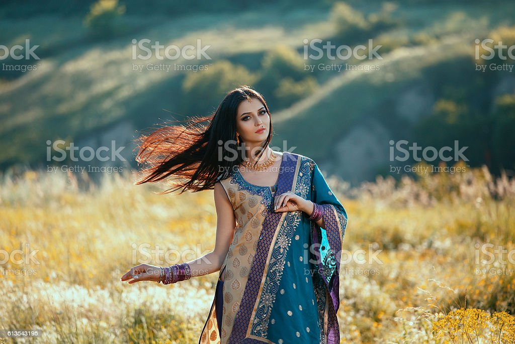 Luxurious Indian woman dancing in traditional natural clothing. stock photo