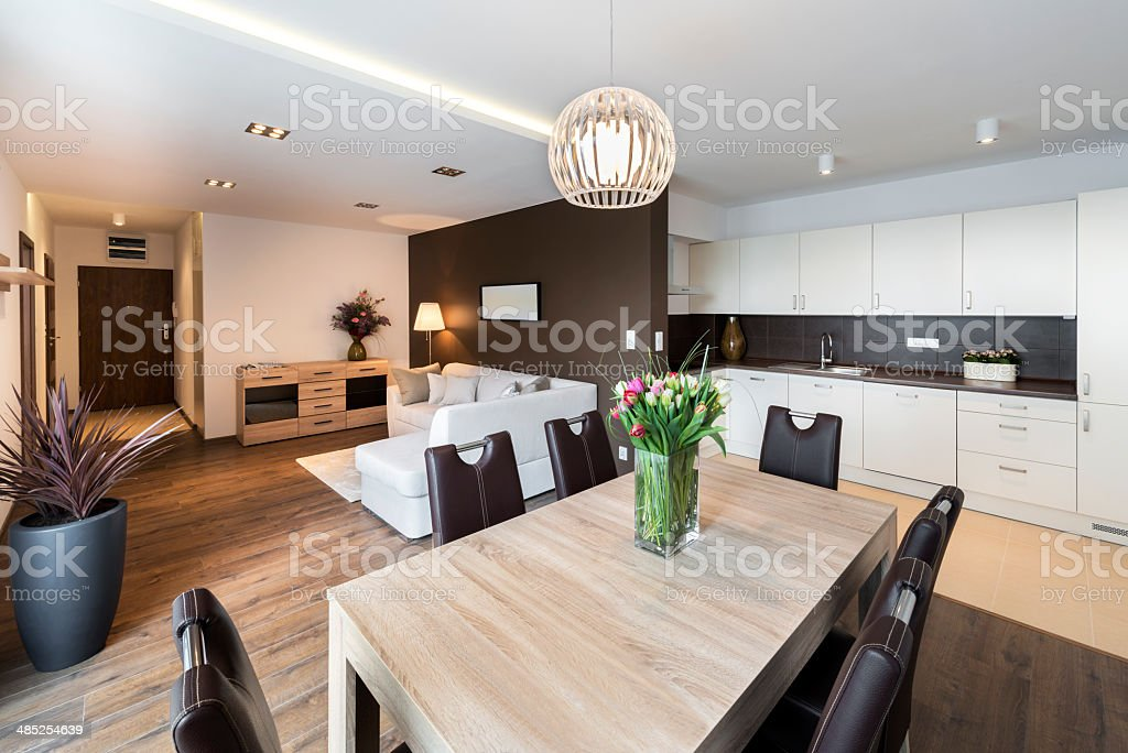 Luxurious kitchen with living area stock photo