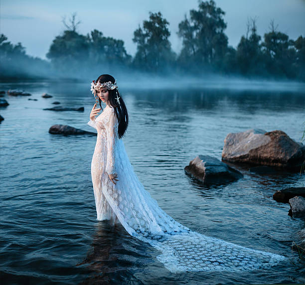 luxurious lady, in elegant long dress in middle of lake - elfen fantasy stock-fotos und bilder
