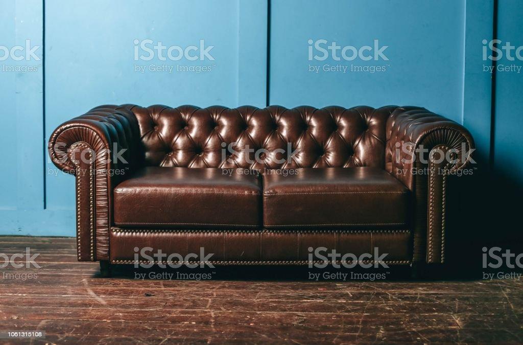 Terrific Luxurious Leather Brown Sofa Blue Wall Classic Vintage Inzonedesignstudio Interior Chair Design Inzonedesignstudiocom
