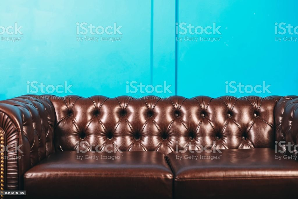 Luxurious Leather Brown Sofa Blue Wall Classic Vintage Furniture Stock Photo Download Image Now Istock