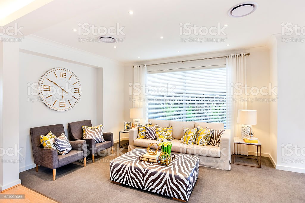 Luxurious living room with animal pattern decoration furnitures stock photo