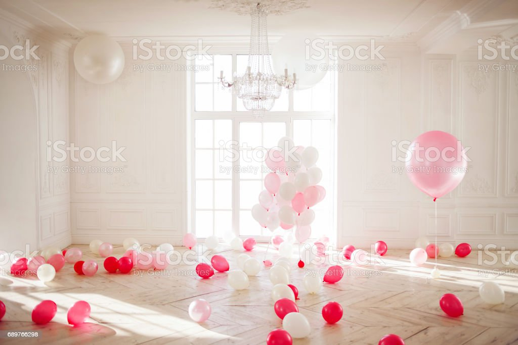 Luxurious living room with large window to the floor. Palace is filled with pink balloons stock photo