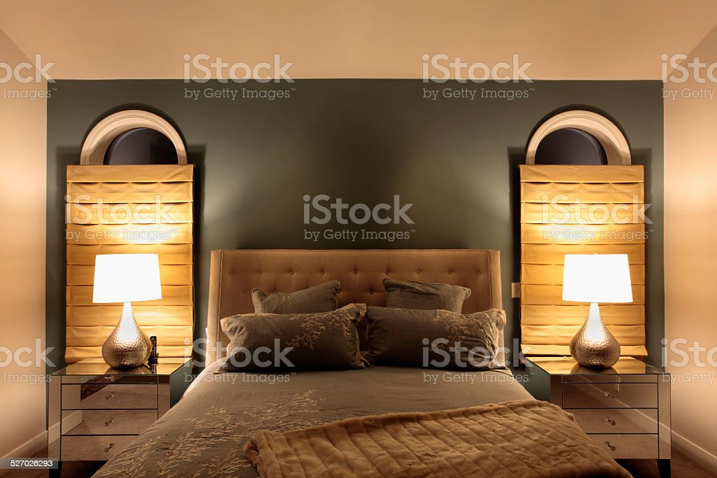 Luxurious Mid Century Modernism Bed And Mirrored Night  Tables stock photo