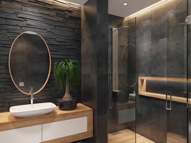 minimalistische luxusbadezimmer mit schiefer schwarz steinmauer - badezimmermöbel holz stock-fotos und bilder