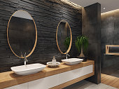 Luxurious minimalist bathroom with slate black stone wall