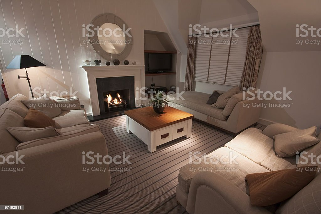 Luxurious modern living room with lit fire royalty-free stock photo