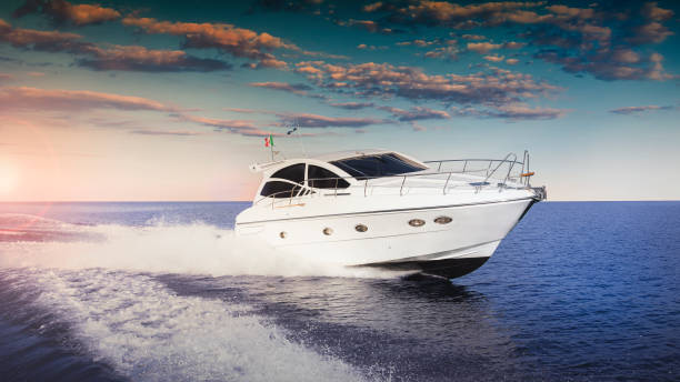 Luxurious motor boat Luxurious motor boat sailing the sea at sunset nautical vessel stock pictures, royalty-free photos & images