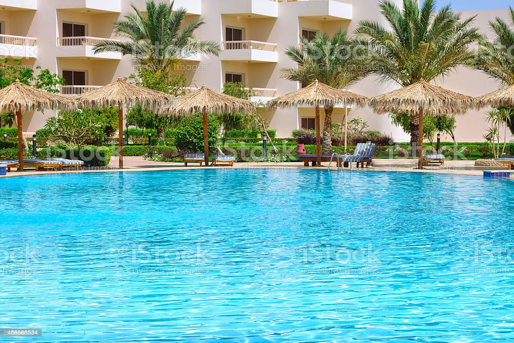 Luxurious open air swimming pool at resort stock photo