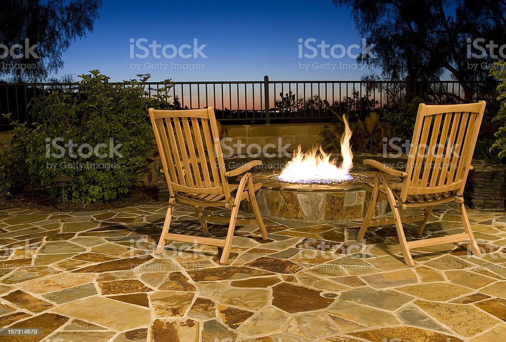 Luxurious outdoor fire pit with seating to view the sunset stock photo