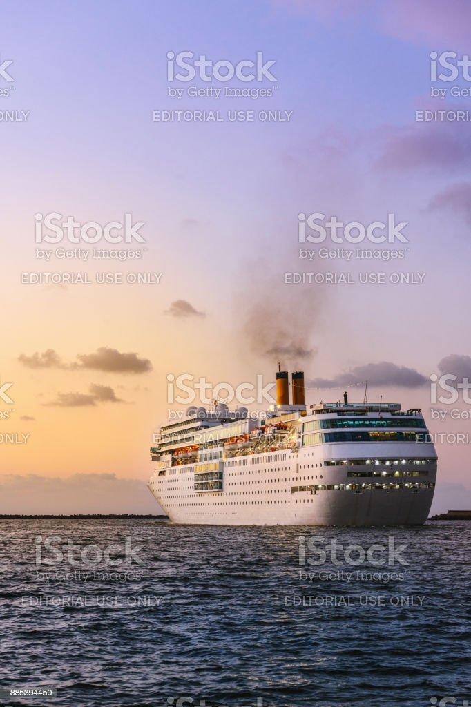 Luxurious passenger liner depart from harbor stock photo