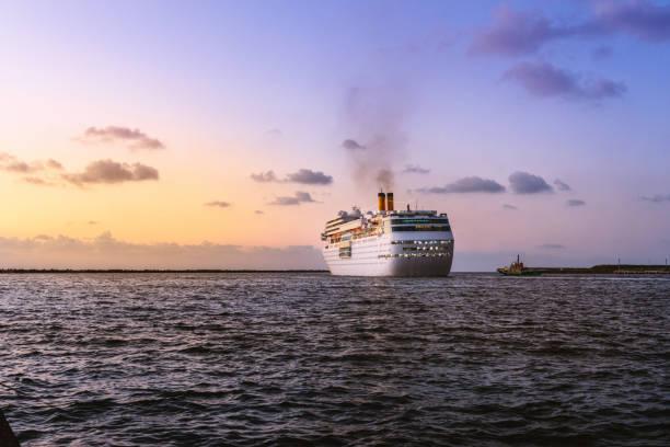 Luxurious passenger liner depart from harbor Kanazawa city ISHIKAWA, JAPAN - September 8,2017 : Luxurious passenger liner depart from harbor in the dusk depart stock pictures, royalty-free photos & images