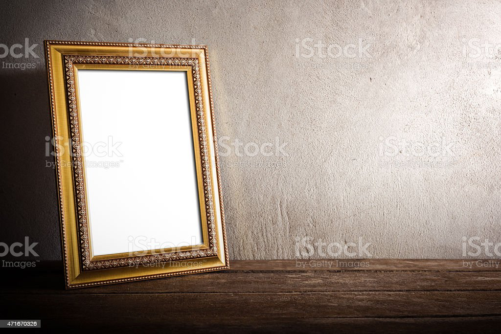 luxurious photo frame on wooden table over grunge background stock photo