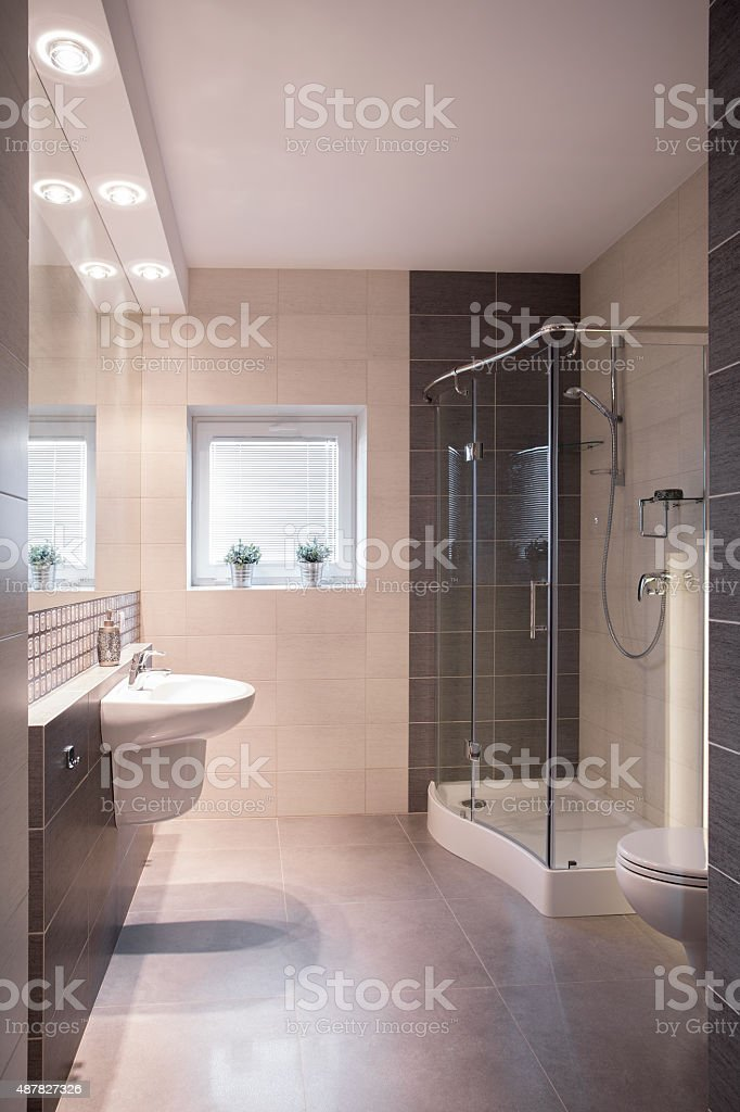 Luxurious refitted bathroom with shower stock photo