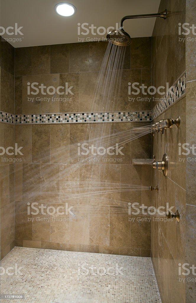 Luxurious running shower. stock photo