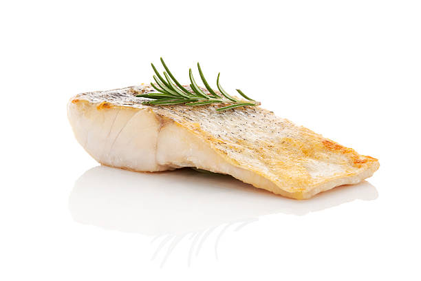 Luxurious seafood dinner. Luxurious seafood dinner. Perch fish fillet isolated on white background with fresh green herbs. Healthy eating. perch fish stock pictures, royalty-free photos & images