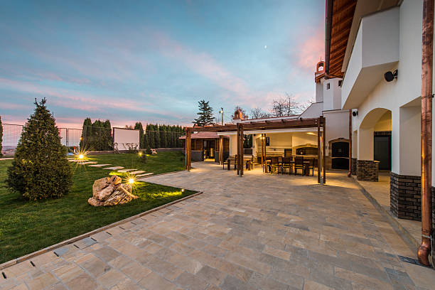 luxurious villa exterior and magic sky - patio stock photos and pictures