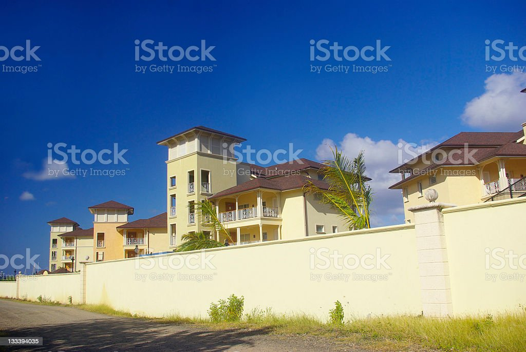 luxurious villas set against sunny tropical blue skies stock photo