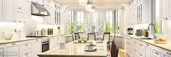Luxurious white kitchen with large windows in a beautiful house