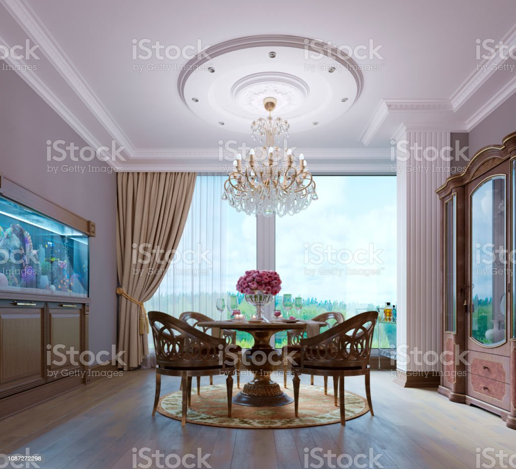 Luxurious wooden dining table and four chairs in the dining room with...