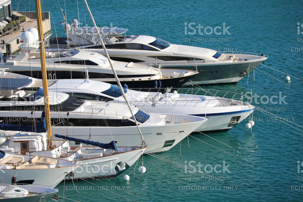 Luxurious Yachts And Megayachts Lined Up in Monaco stock photo
