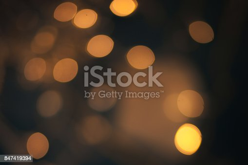 846933050 istock photo Luxury Abstract Shining Party Background with Sparkling  Lights and golden bokeh. Christmas Design. Colorful circles of dark nights  defocussed background