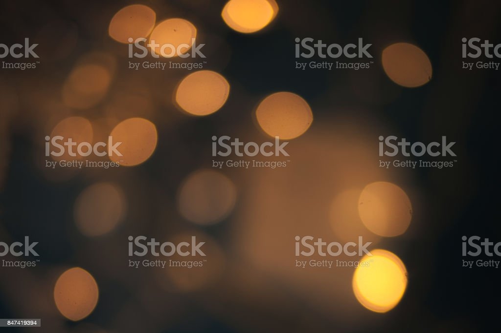 Luxury Abstract Shining Party Background with Sparkling  Lights and golden bokeh. Christmas Design. Colorful circles of dark nights  defocussed background'n stock photo