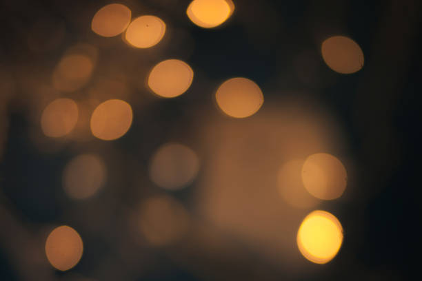 Luxury Abstract Shining Party Background with Sparkling  Lights and golden bokeh. Christmas Design. Colorful circles of dark nights  defocussed background