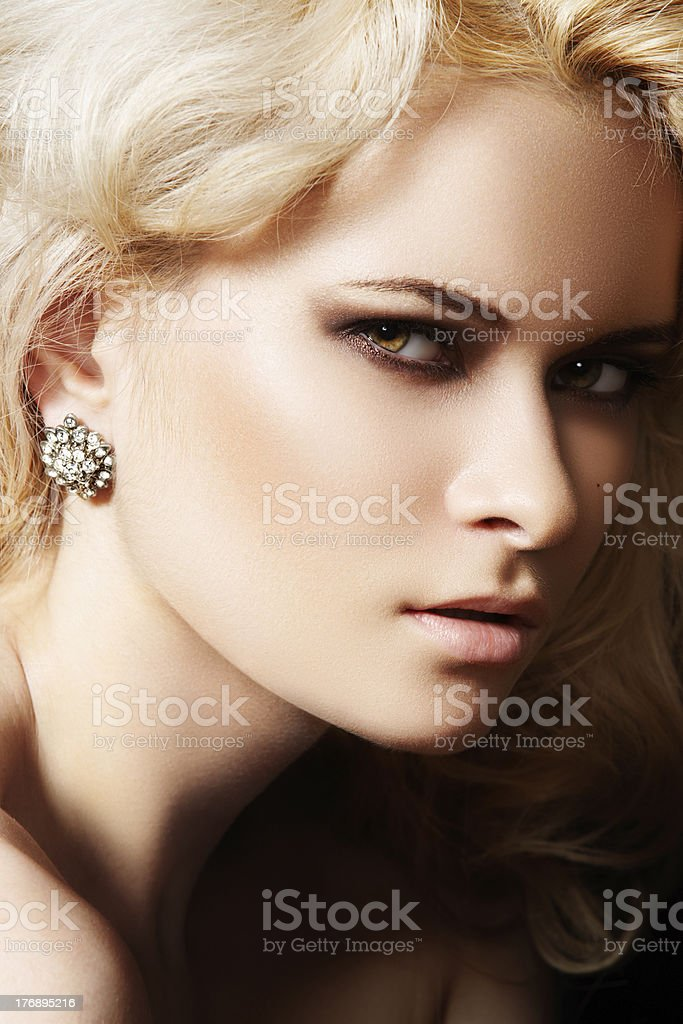 Luxury and fashion style. Female face with make-up stock photo