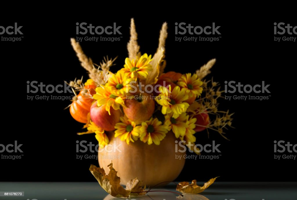 Luxury autumn bouquet of flowers and fruit, isolated on black stock photo