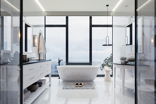 Interior of a contemporary luxury white bathroom with washstand and bathtub.