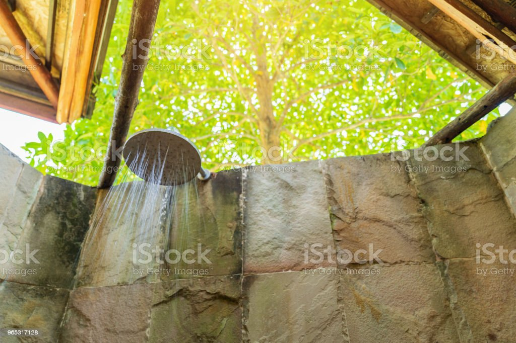 Luxury bathroom with shower outdoors on tree background. zbiór zdjęć royalty-free