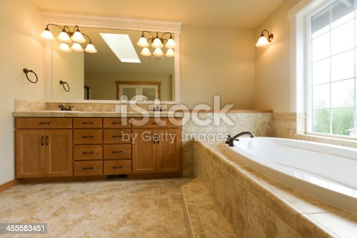 istock Luxury bathroom with travertine floors 455583451