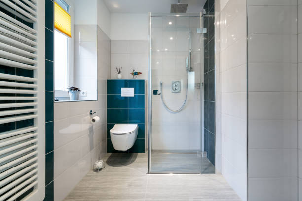 luxury bathroom with walk in glass shower - horizontal shot of a luxury bathroom with large, walk-in shower. - bathroom renovation stock photos and pictures