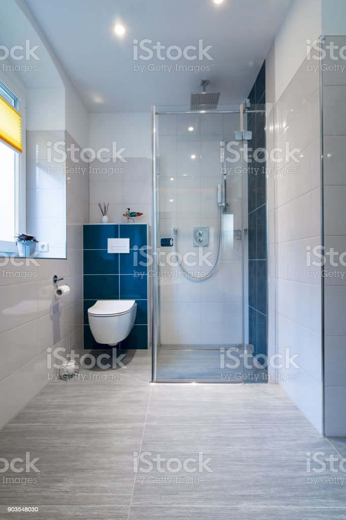Luxury Bathroom with walk in Glass Shower - Vertical shot of a luxury bathroom with large, walk-in shower. stock photo