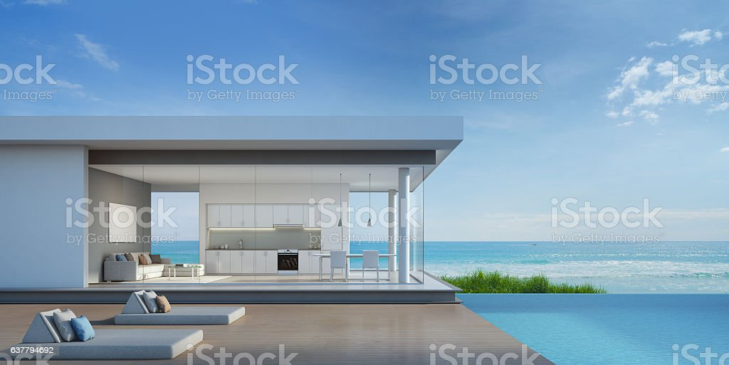 Luxury beach house with sea view pool in modern design foto de stock libre de derechos