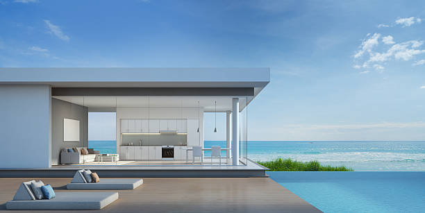 Luxury beach house with sea view pool in modern design stock photo