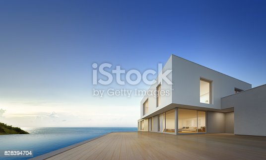 istock Luxury beach house with sea view swimming pool and empty terrace in modern design, Vacation home for big family on blue sky background 828394704