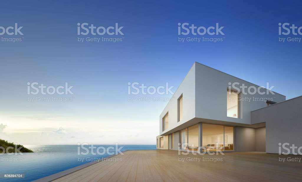 Luxury beach house with sea view swimming pool and empty terrace in modern design, Vacation home for big family on blue sky background stock photo