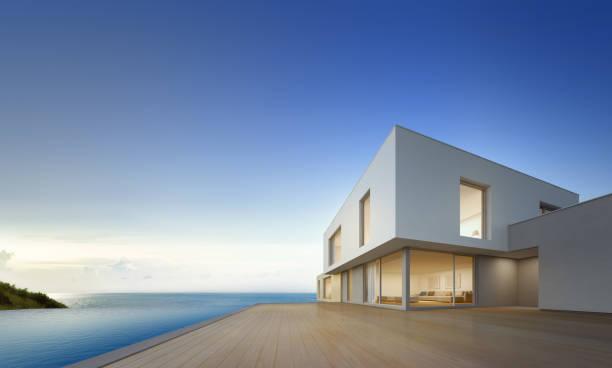 casa de playa de lujo con piscina de vista mar y terraza vacía en diseño moderno, casa para familia grande sobre fondo de cielo azul - nueva casa fotografías e imágenes de stock