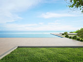 istock Luxury beach house with sea view swimming pool and terrace in modern design. 1292403267