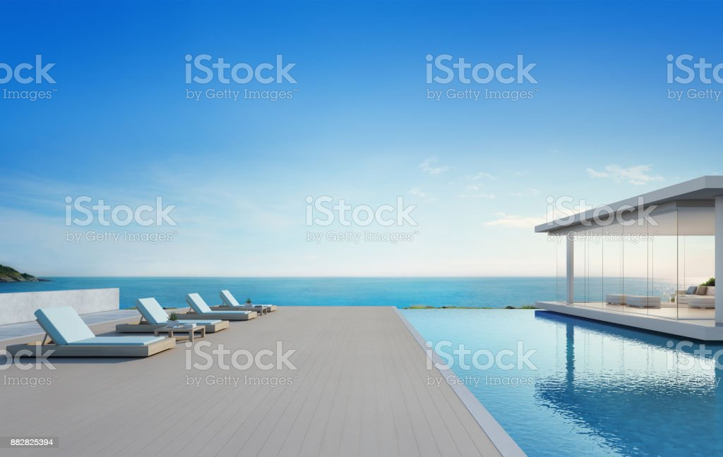 Luxury beach house with sea view swimming pool and terrace in modern design, Lounge chairs on wooden floor deck at vacation home or hotel - 3d illustration of contemporary holiday villa exterior stock photo