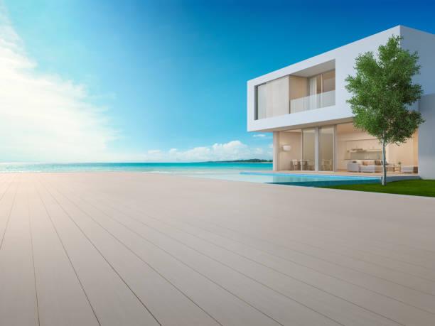 luxus-strand-haus mit swimmingpool mit blick auf meer und terrasse in modernem design, leere holzboden terrasse am ferienhaus oder hotel - 3d darstellung der zeitgenössischen urlaub villa außen - ferienhaus thailand stock-fotos und bilder
