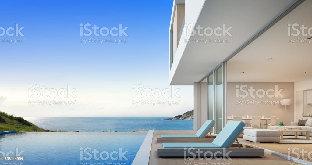Luxury beach house with sea view swimming pool and terrace near living room in modern design, Vacation home or holiday villa for big family stock photo
