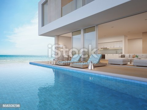 istock Luxury beach house with sea view swimming pool and terrace near living room in modern design, Vacation home or holiday villa for big family 858309298