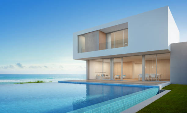 Luxury beach house with sea view swimming pool in modern design, Vacation home for big family stock photo