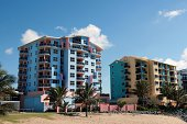 Apartment buildings in a tropical setting. Click to see more...